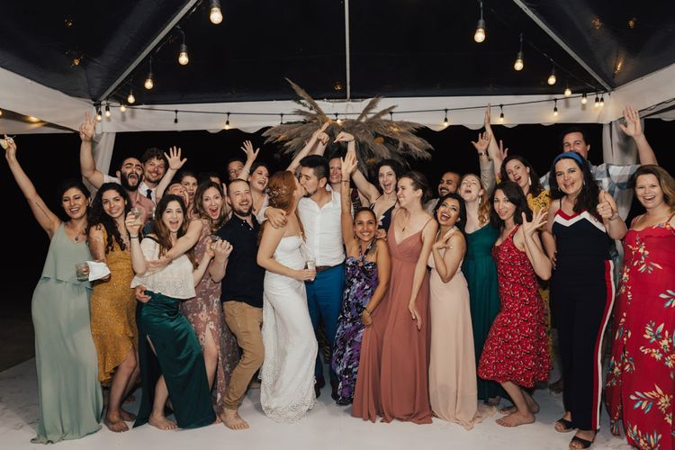 Bride and Groom With All Their Guests During The Evening Celebration