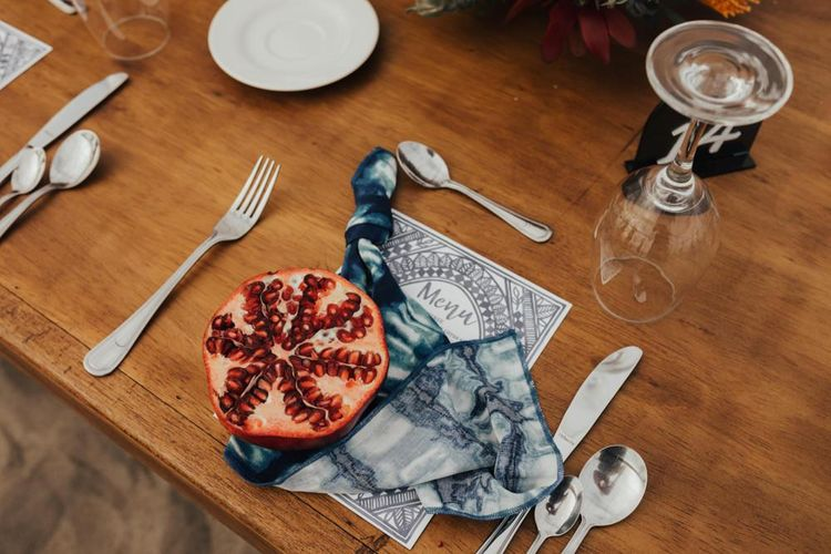 Wedding Table Setting With Half Pomegranate