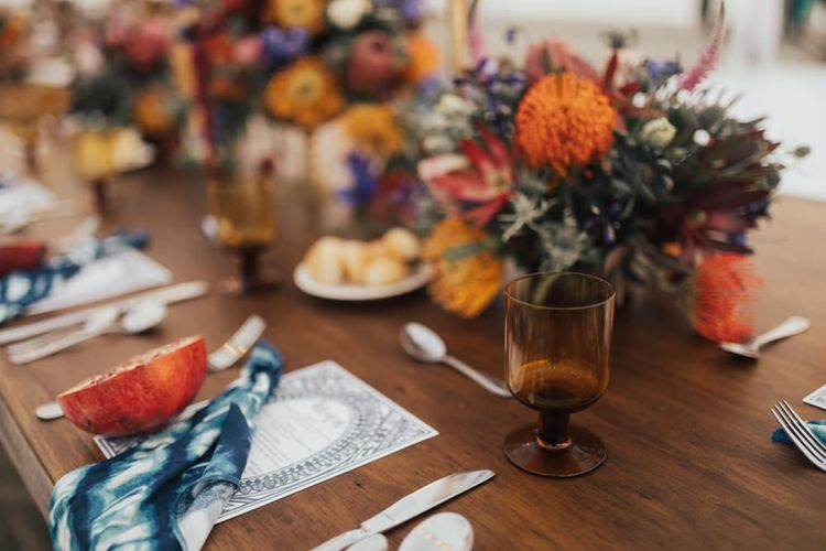 Table Place Setting with Orange and Red Flowers