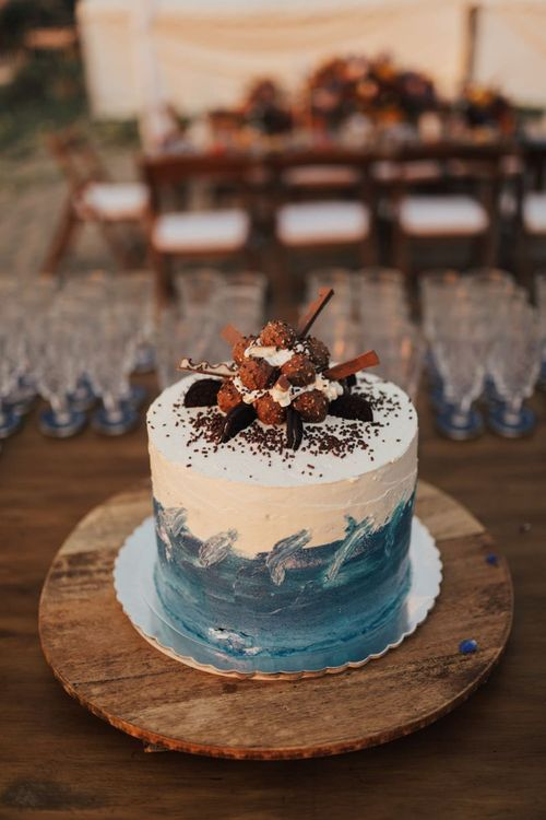 Wedding Cake With Blue Detail and Chocolate Decor