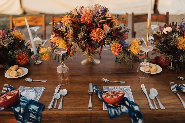 Large Wedding Table Flowers in Gold Vase
