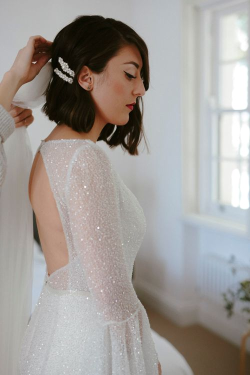 Bride in Sparkly Emma Beaumont Dress with Statement Sleeves, Keyhole Back and Leg Split | Simone Rocha Pearl Hair Slides | Charlie Brear Cathedral Length Veil | Gin Bike & Monochrome Wedding with Bell Sleeve Emma Beaumont Wedding Dress | Ruth Atkinson Photography