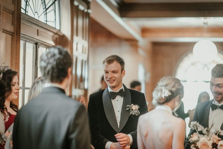 Bride And Groom Mingle With Guests