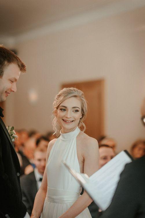 Bridal Beauty During Ceremony In Halterneck Bride Dress
