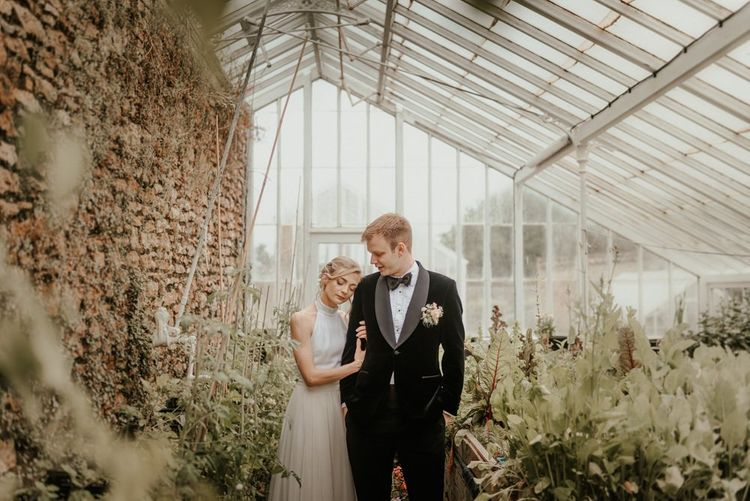 Bride and Groom In Coombe Lodge Greenhouse
