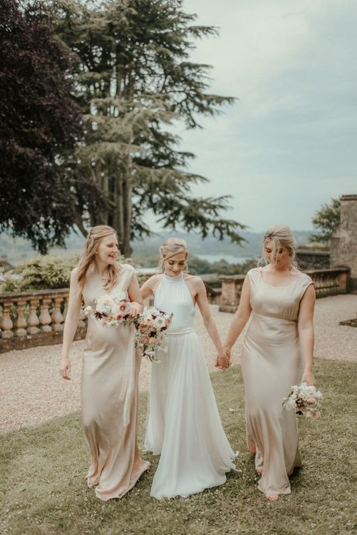 Bridal Party In Neutral Tones and Pink Flowers With Bride In Stella McCartney Wedding Dress