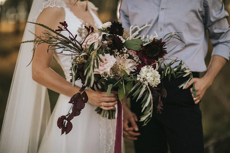 Burgundy Floral Bouquet & Ribbon by Quintessential Wild Florist | Romantic, Bohemian Elopement in the Peaks by Natalie Hewitt Wedding Planner | Henry Lowther Photography