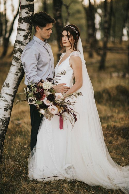 Burgundy Floral Bouquet & Ribbon by Quintessential Wild Florist | Bride in Gown from Frances Day Bridal | Groom in Moss Bros. | Romantic, Bohemian Elopement in the Peaks by Natalie Hewitt Wedding Planner | Henry Lowther Photography