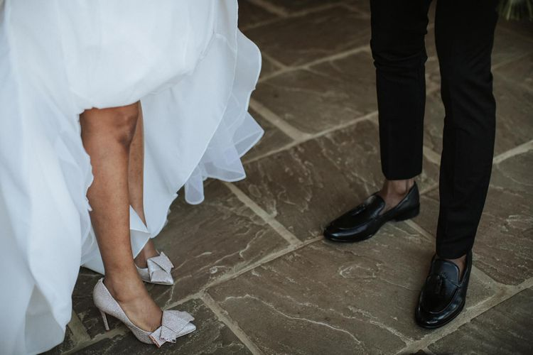 Gold glitter wedding shoes with bows at The Old Kent Barn wedding