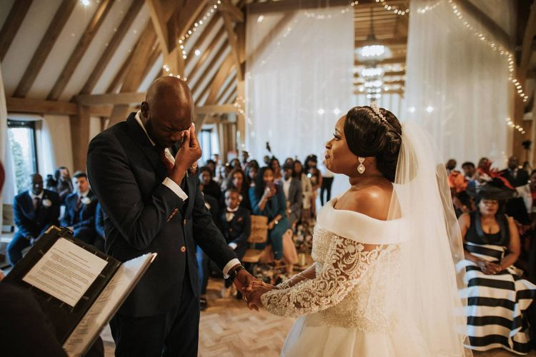 Emotional wedding ceremony at The Old Kent Barn wedding venue