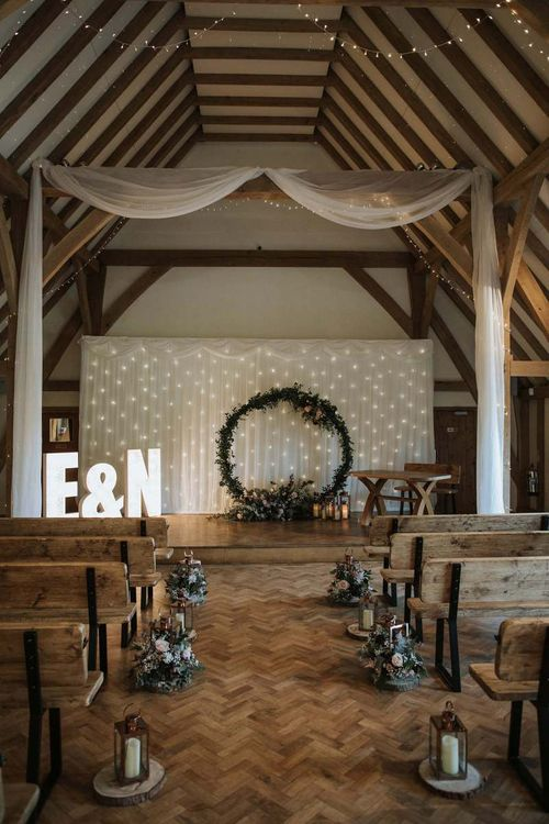 Aisle and altar wedding decor at The Old Kent Barn wedding venue