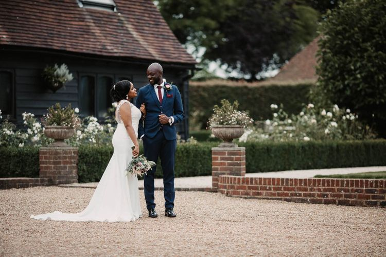 Bride and groom portraits in the courtyard of The Old Kent Barn