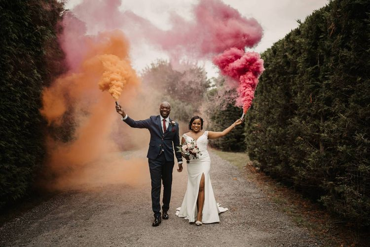 Bride and groom smoke bomb portraits at The Old Kent barn