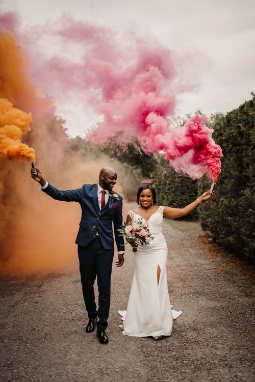 Bride and groom smoke bomb portrait by Olegs Samsonovs