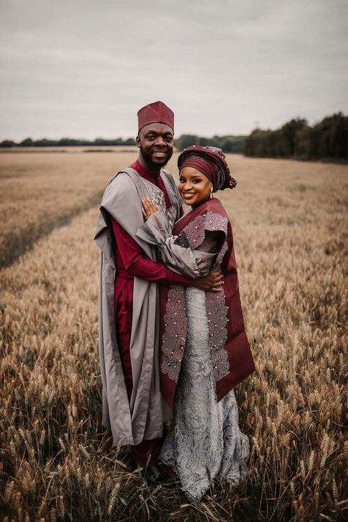 Bride and groom in traditional African wedding robes at The Old Kent Barn
