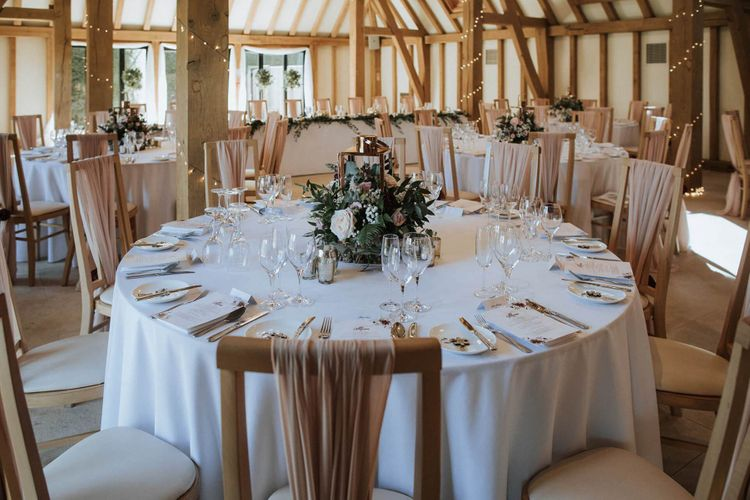 Round tables at The Old Kent Barn wedding reception