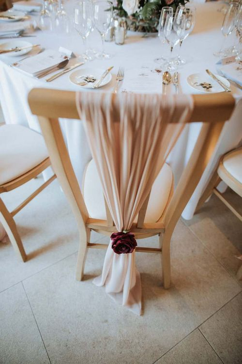Tulle chair back decor tied with flower