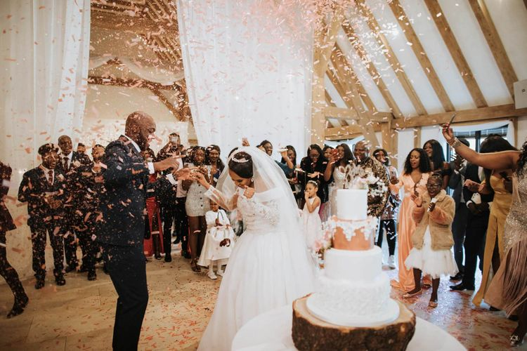 Bride and groom dancing under a confetti bomb