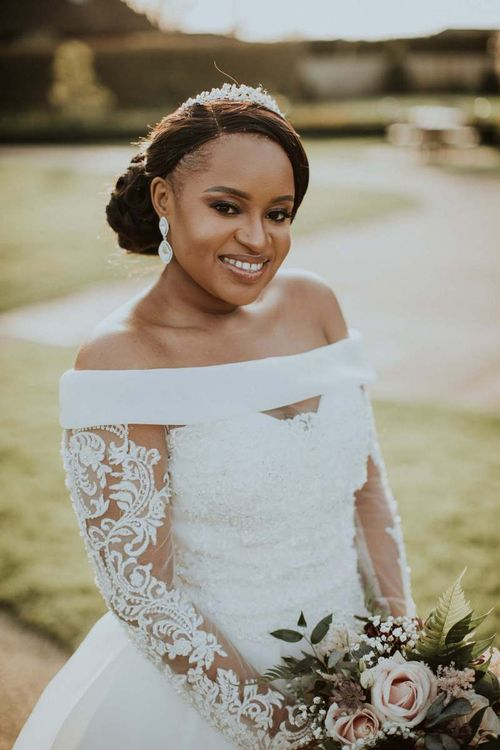 Beautiful black bride in off the shoulder wedding dress with long sleeves and full skirt  for The Old Kent Barn wedding