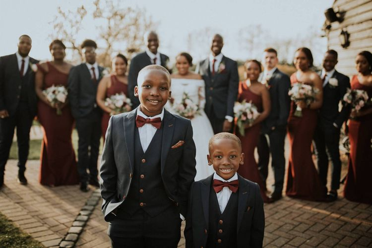 Page Boys in navy suits and burgundy ties like the groomsmen