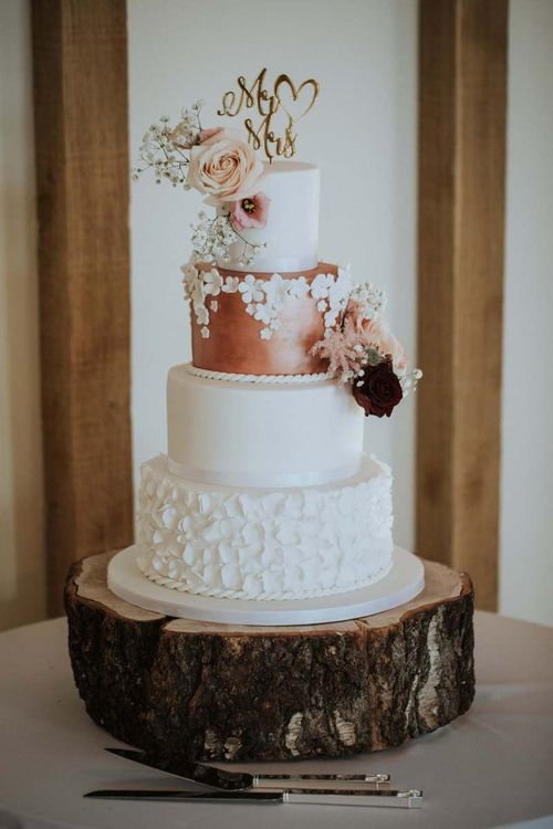 Classic four tier wedding cake on Tree stump cake stand