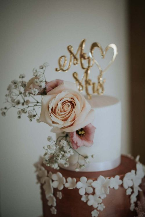 Gold cake topper and floral decor