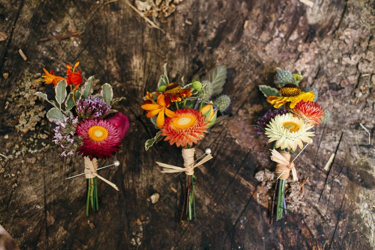 Colourful Buttonholes | Macrame Decor, Vintage Caravan Photobooth and Five-Tier Naked Wedding Cake for Boho Wedding in Woodlands | Freckle Photography