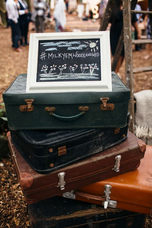 Vintage Suitcases | Chalkboard Wedding Sign | Macrame Decor, Vintage Caravan Photobooth and Five-Tier Naked Wedding Cake for Boho Wedding in Woodlands | Freckle Photography