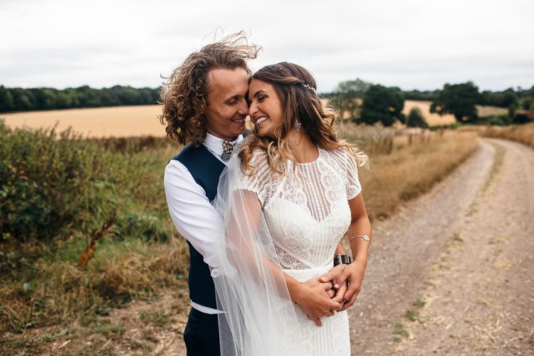 Bride in Lenora Dress by Wtoo Watters with Lace Cap Sleeves and Keyhole Back | Groom in Blue Waistcoat and Trousers with Colourful Patterned Bow Tie | Macrame Decor, Vintage Caravan Photobooth and Five-Tier Naked Wedding Cake for Boho Wedding in Woodlands | Freckle Photography