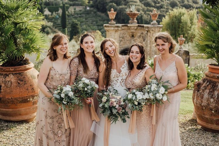 Bridal Party With Bridesmaids in Pink and Rose Gold Dresses
