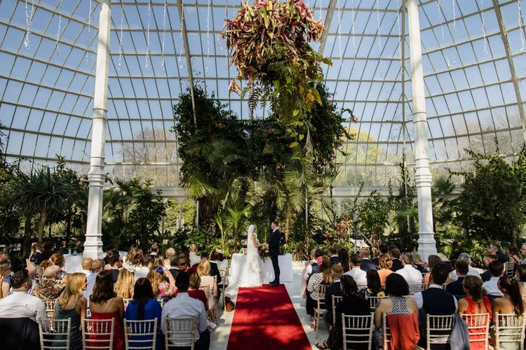 Wedding ceremony in Liverpool glass house with white bridesmaid dresses