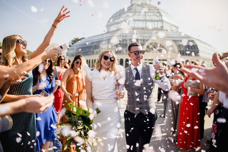 Confetti exit for bride and groom with white bridesmaid dresses
