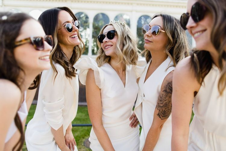 White bridesmaid dresses with sunglasses
