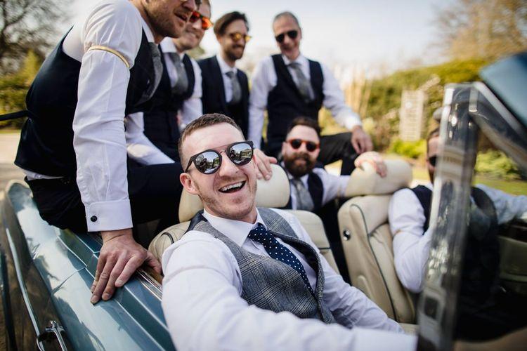 Groomsmen in wedding car
