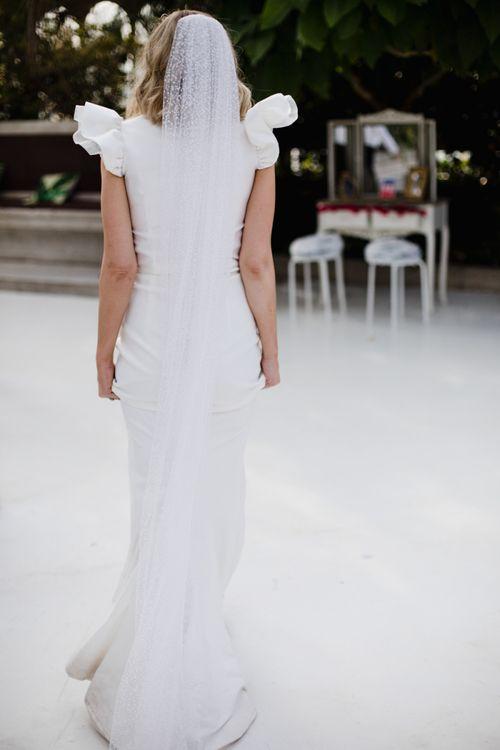 Polka dot wedding veil with ruffle sleeve dress  at wedding with white bridesmaid dresses