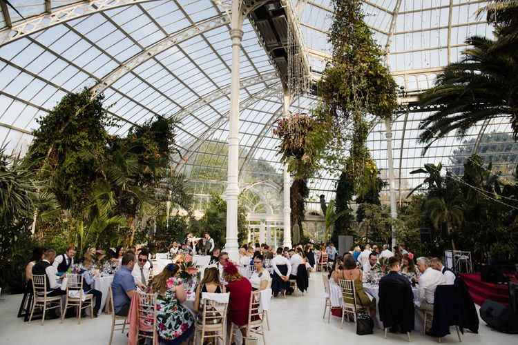 Wedding in palm house Sefton Park in Liverpool with white bridesmaid dresses