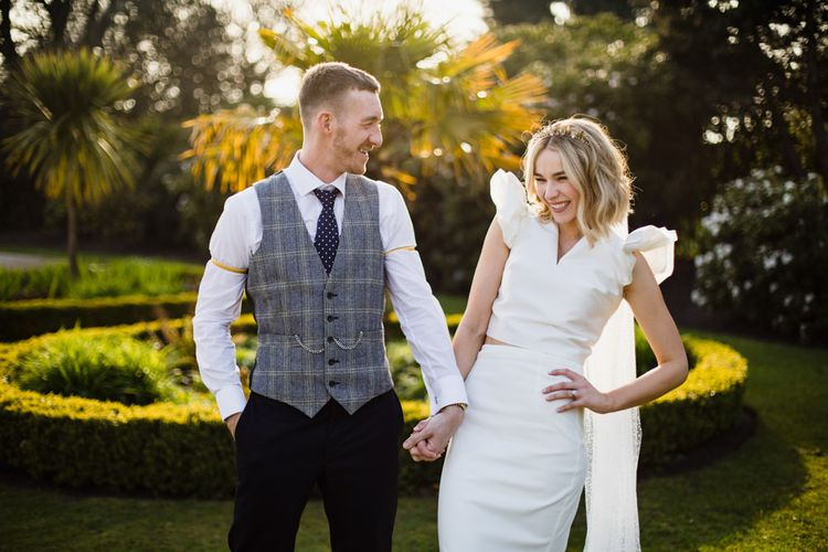 Ruffle sleeve wedding dress with white bridesmaid dresses at Liverpool wedding