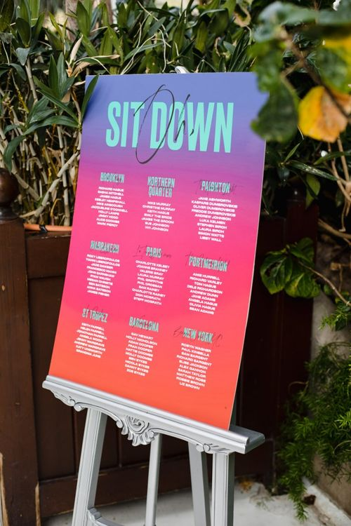 Bright table plan and wedding stationery
