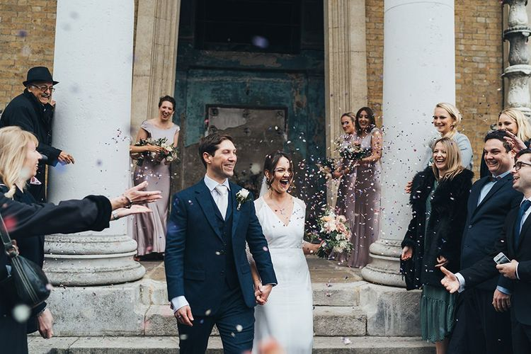 Bride and Groom Confetti Exit Bridesmaids in Dusky Pink Bridesmaid Dresses