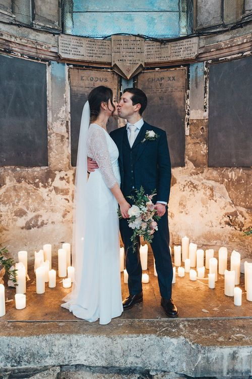 Bride and Groom with Candle Backdrop