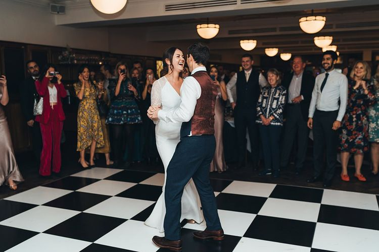 Bride and Groom First Dance with Dusky Pink Bridesmaid Dresses