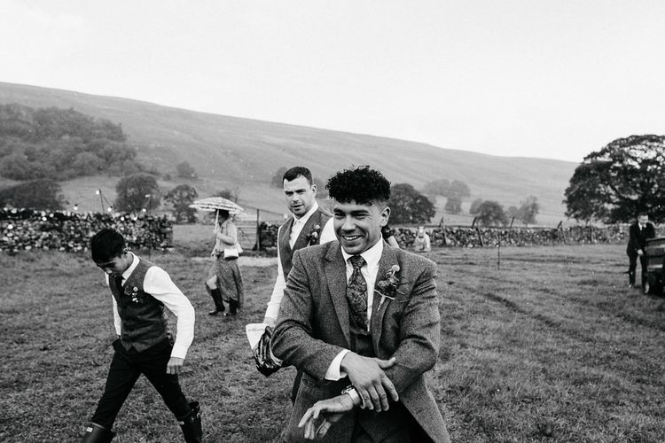 Groomsmen in Tweed Suit   Brightly Coloured Festival Wedding with Outdoor Humanist Ceremony & Tipi Reception on the Yorkshire Dales   Tim Dunk Photography