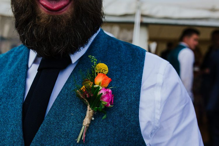 Colourful Flower Buttonhole   Brightly Coloured Festival Wedding with Outdoor Humanist Ceremony & Tipi Reception on the Yorkshire Dales   Tim Dunk Photography