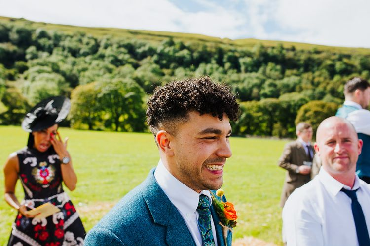 Wedding Ceremony    Groom at the Altar in Tweed Suit   Brightly Coloured Festival Wedding with Outdoor Humanist Ceremony & Tipi Reception on the Yorkshire Dales   Tim Dunk Photography