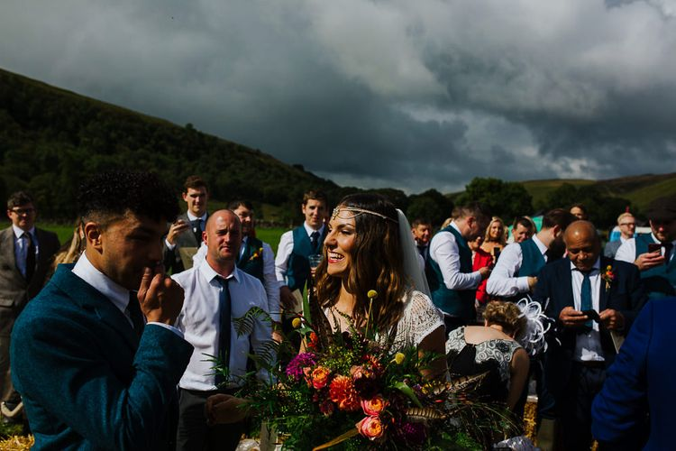 Wedding Ceremony    Bridal Entrance  in Daughters of Simone Lace Gown   Brightly Coloured Festival Wedding with Outdoor Humanist Ceremony & Tipi Reception on the Yorkshire Dales   Tim Dunk Photography