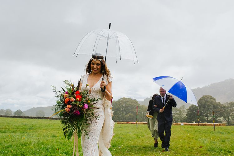 Bride in Daughters of Simone Lace Gown    Brightly Coloured Festival Wedding with Outdoor Humanist Ceremony & Tipi Reception on the Yorkshire Dales   Tim Dunk Photography