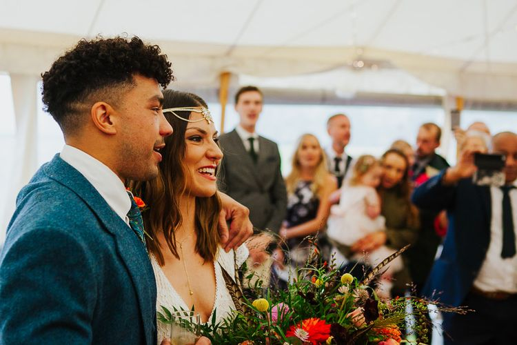 Wedding Ceremony    Bride in Daughters of Simone Lace Gown   Groom in Tweed Suit   Brightly Coloured Festival Wedding with Outdoor Humanist Ceremony & Tipi Reception on the Yorkshire Dales   Tim Dunk Photography