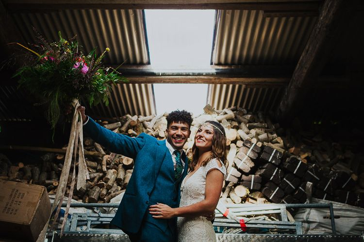 Bride in Daughters of Simone Lace Gown   Groom in Tweed Suit   Brightly Coloured Festival Wedding with Outdoor Humanist Ceremony & Tipi Reception on the Yorkshire Dales   Tim Dunk Photography