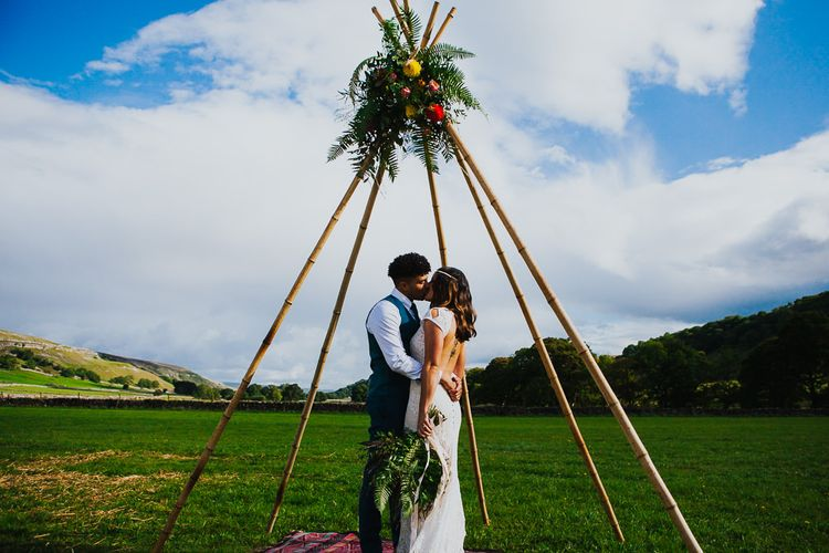 Naked Tipi    Bride in Daughters of Simone Lace Gown   Groom in Tweed Suit   Brightly Coloured Festival Wedding with Outdoor Humanist Ceremony & Tipi Reception on the Yorkshire Dales   Tim Dunk Photography