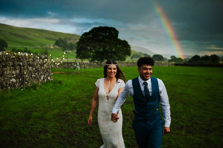 Rainbow   Bride in Daughters of Simone Lace Gown   Groom in Tweed Suit   Brightly Coloured Festival Wedding with Outdoor Humanist Ceremony & Tipi Reception on the Yorkshire Dales   Tim Dunk Photography